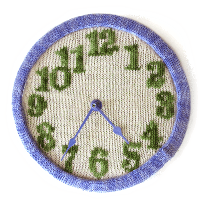 knitted clock pattern in purple, green, and neutral