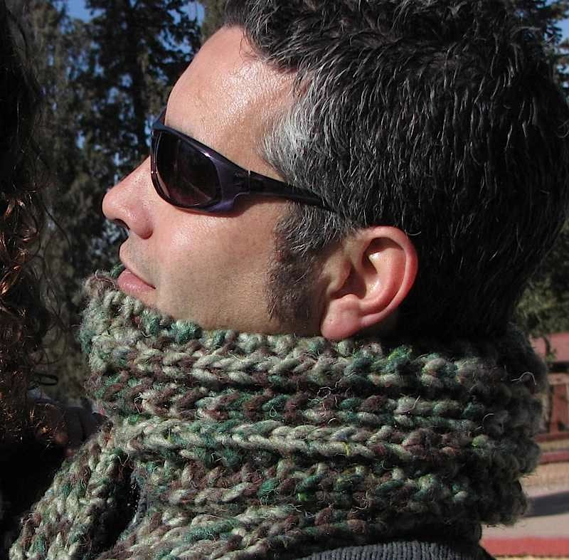 Gorgeous guy wearing a mistake-rib scarf in bulky yarn