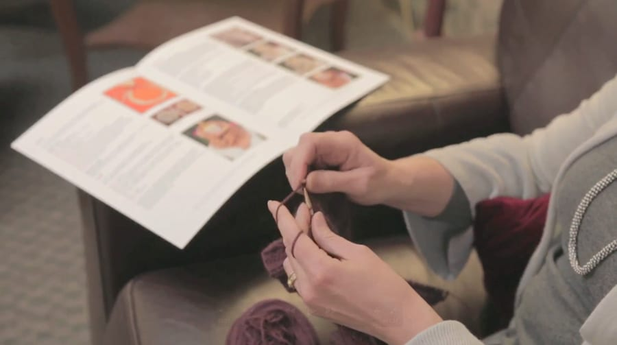 Happy knitter with correct tension (left-handed)