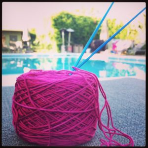 Knitting by the pool in Palm Springs