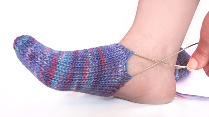 Start your Fleegle Heel increases when the knitting touches the front of your ankle