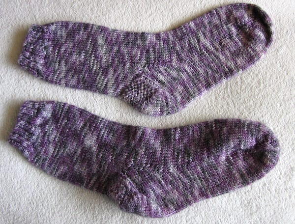 Comparison of previously blocked and unblocked sock after wash and dry