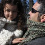 Man modeling a mistake rib scarf with his daughter