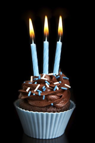 cupcake with three candles