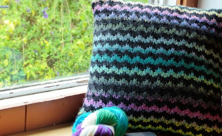 A zigzag striped pillow with a self-striping yarn